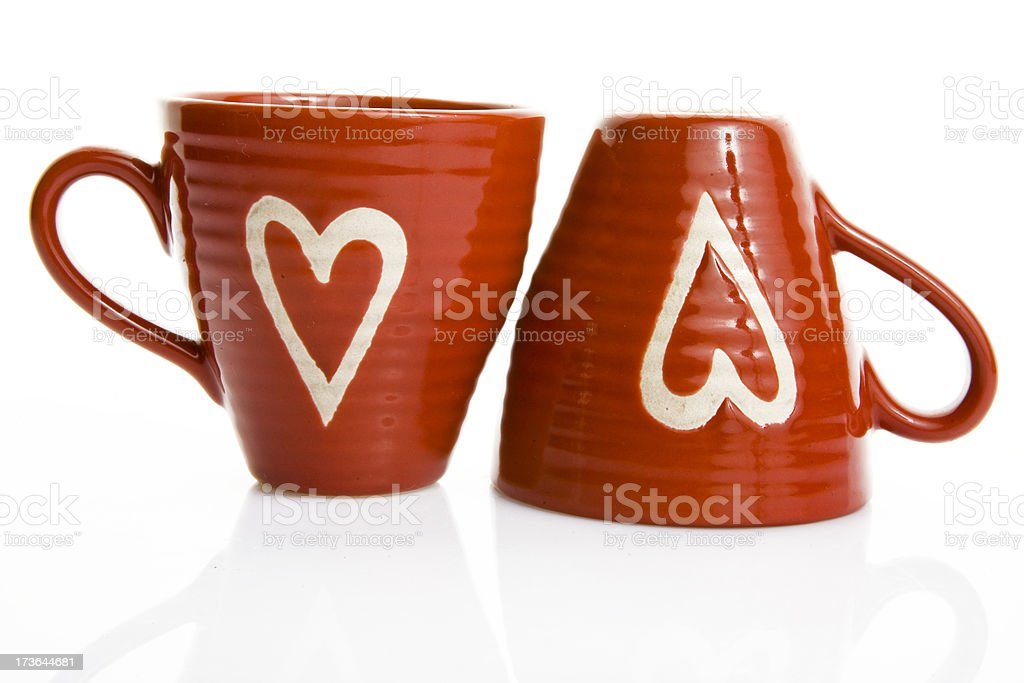 two red coffee cups with hearts on white background stock photo