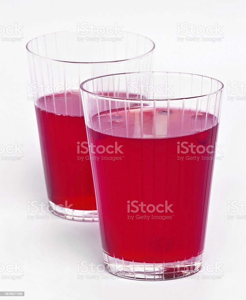 Two red cranberry fruit drinks royalty-free stock photo
