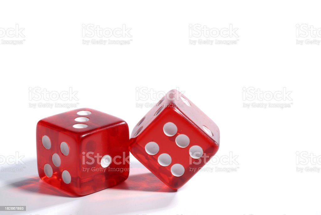 Two red dices made with glass like material with white dots stock photo