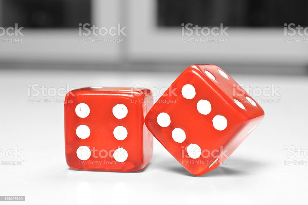 Two red dices on game room table royalty-free stock photo