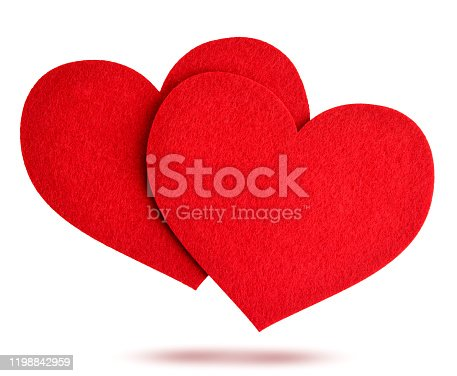 Two red felt hearts fly on a white background, isolated. Valentines day