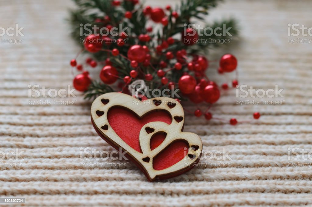 Two red hearts made of wood on a woolen knit background stock photo