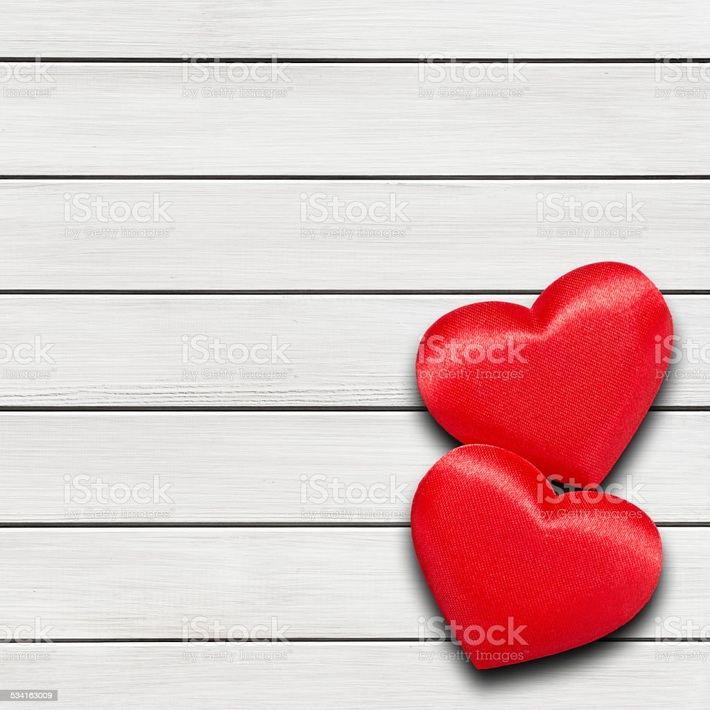 Two red hearts on white wood background stock photo