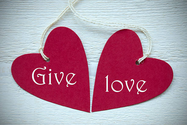 Two Red Hearts With Give Love stock photo