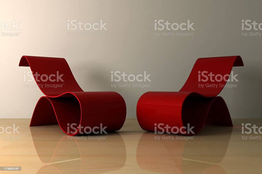 Two red, modern-style chairs with unusual curves royalty-free stock photo