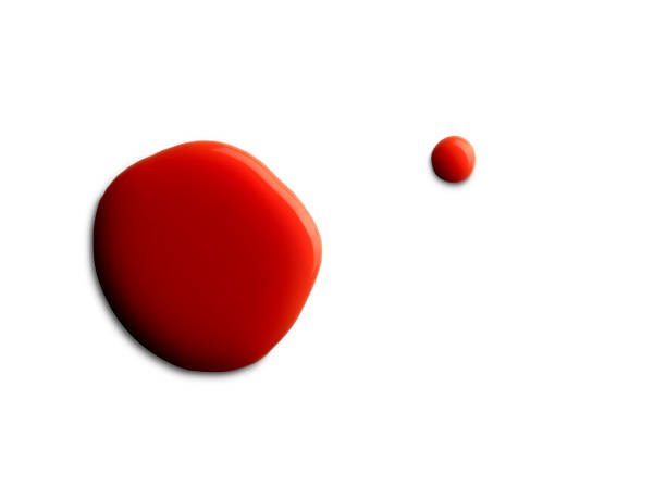 two red paint stains on white background stock photo