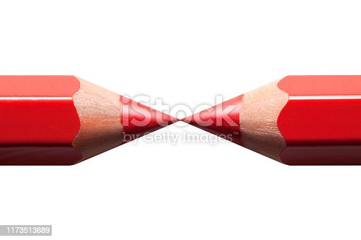 istock Two red pencils with touching tips on white background 1173513689