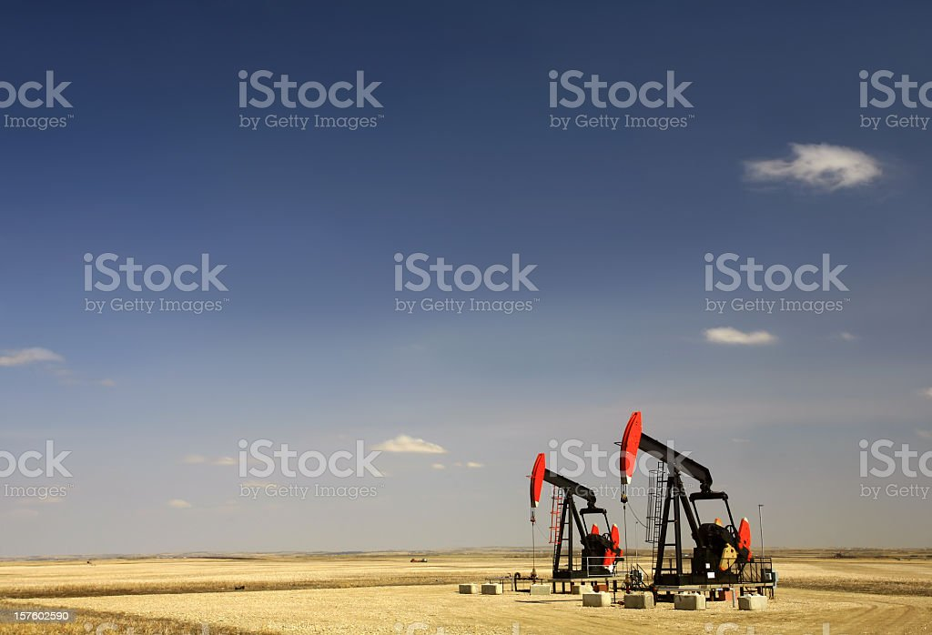 Two Red Pumpjacks in North Dakota Oil Field stock photo