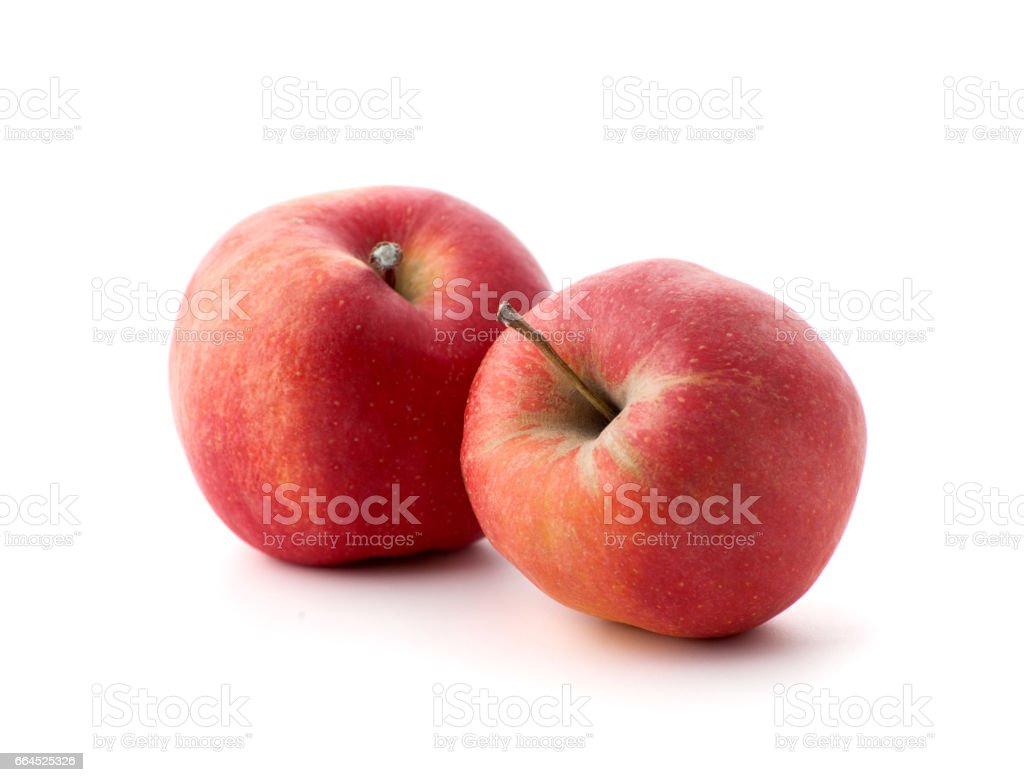 Two red ripe apples on a white background. royalty-free stock photo