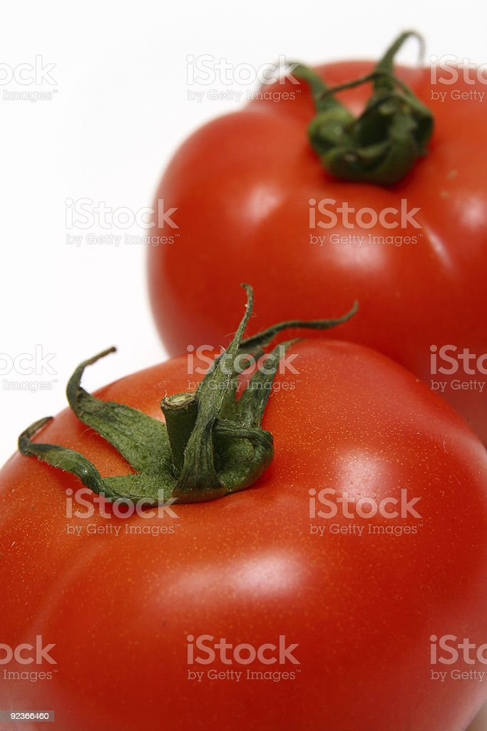 Two red tomatoes royalty-free stock photo