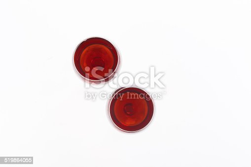 istock Two red wine glass isolated on white background 519864055