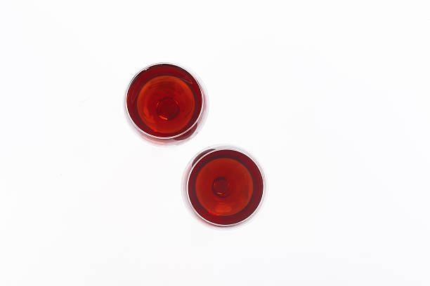 two red wine glass isolated on white background - wine glass stock photos and pictures