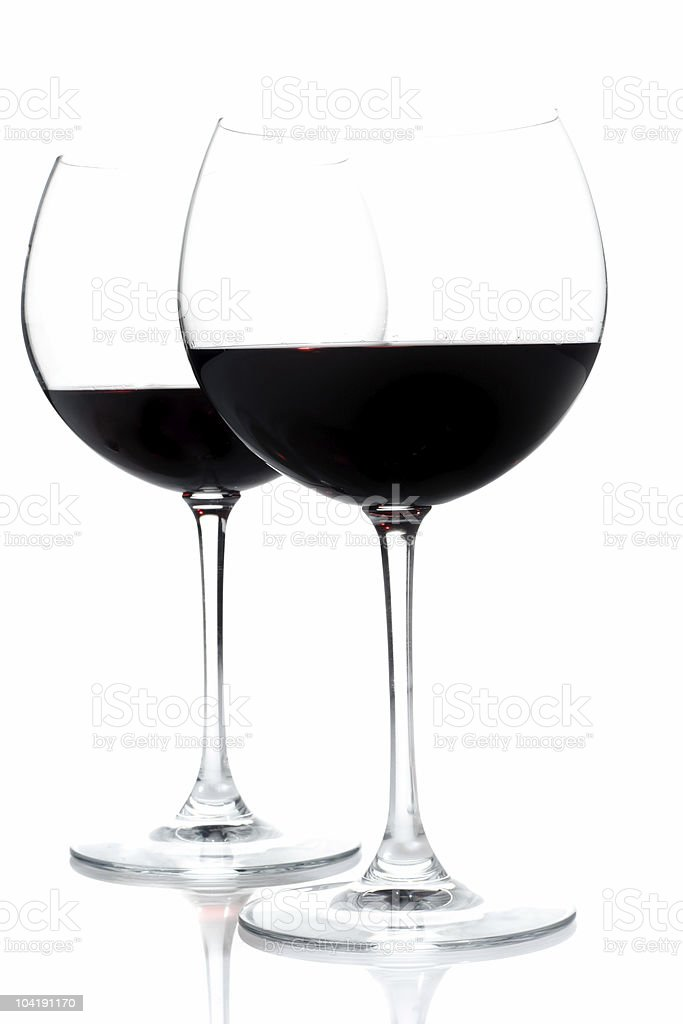 Two red wine glasses isolated on white royalty-free stock photo