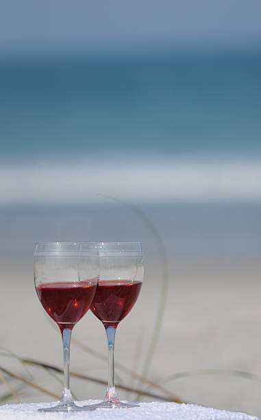 Two Red Wine Glasses on the Beach stock photo