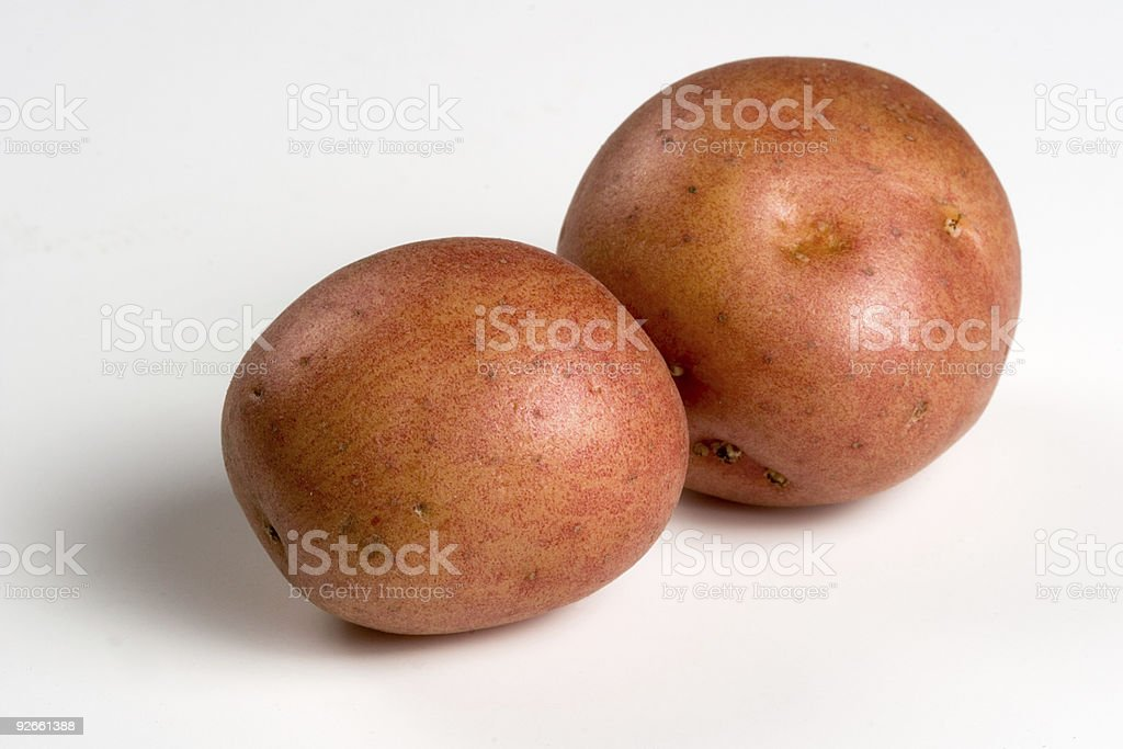 Two red-skinned potatoes stock photo