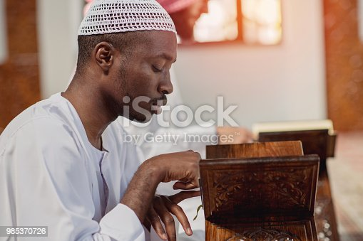 istock Two religious muslim man praying together inside the mosque 985370726