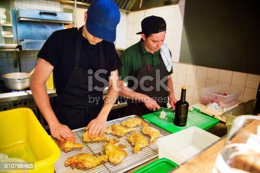 istock Two restaurant chefs preparing chicken 510798463