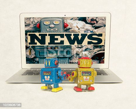 two retro bobots learn watching fake news isolated