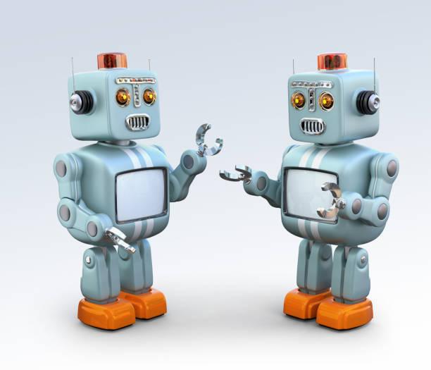 deux robots rétro parler les uns aux autres - chatbot photos et images de collection