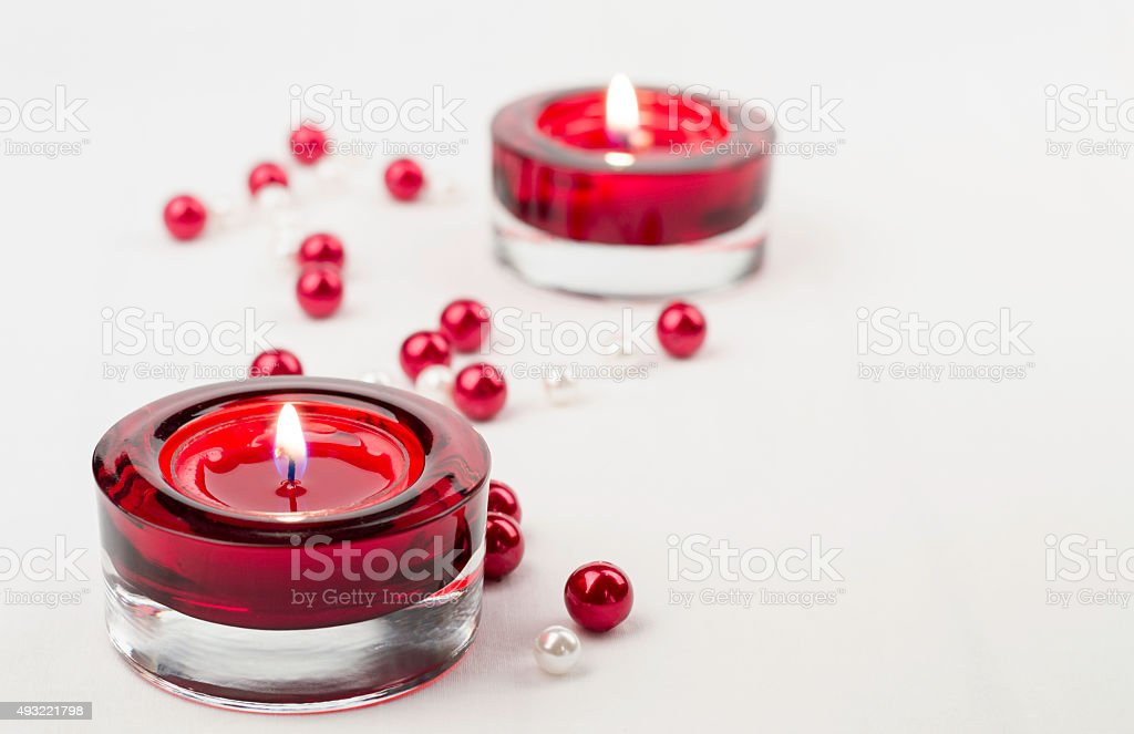 Two rich red candle holder votive and pearls stock photo