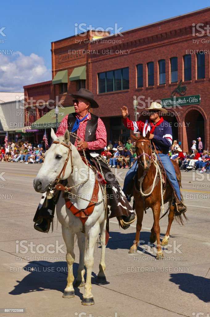 Two riders greet the spectators while riding with the Independence Day Parade stock photo