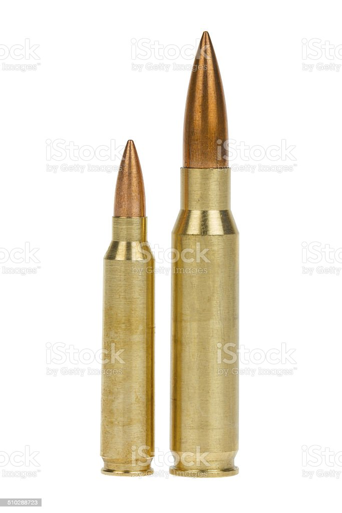 Two rifle bullets over white background stock photo