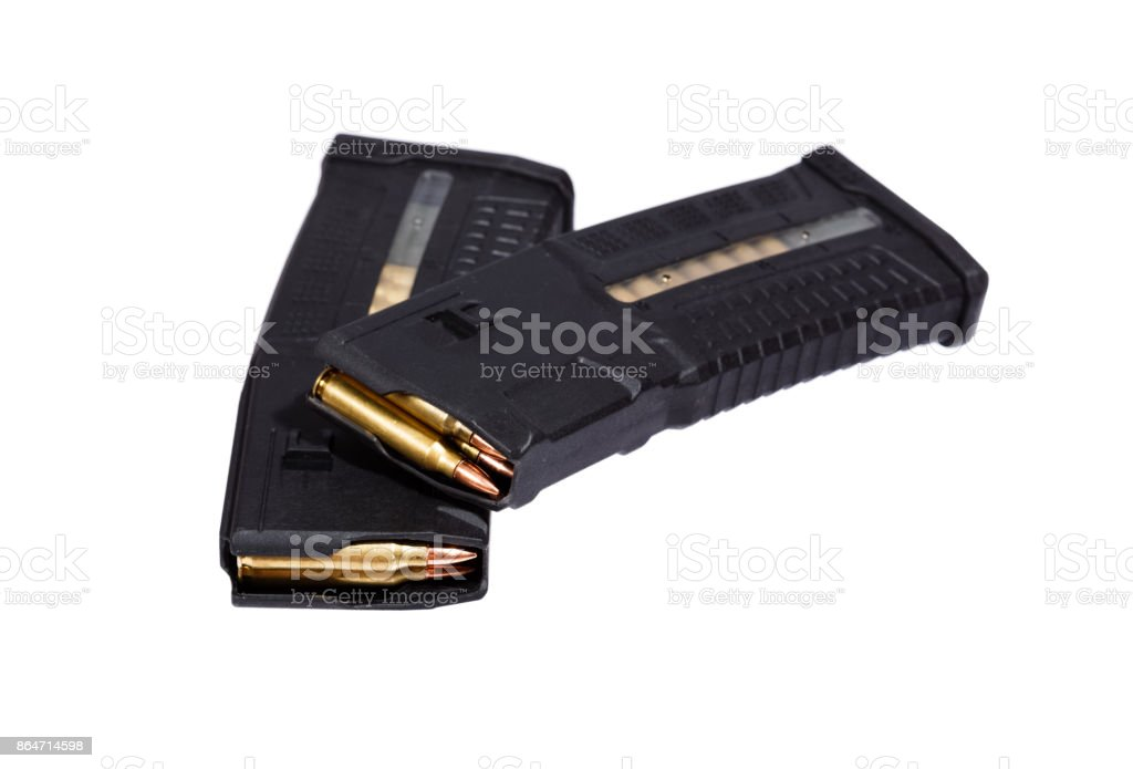 Two rifle magazins with bullets stock photo