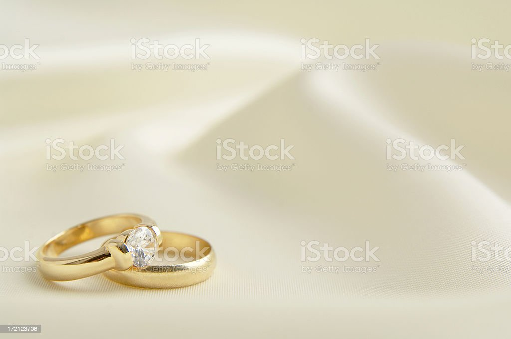 Two rings in white background stock photo