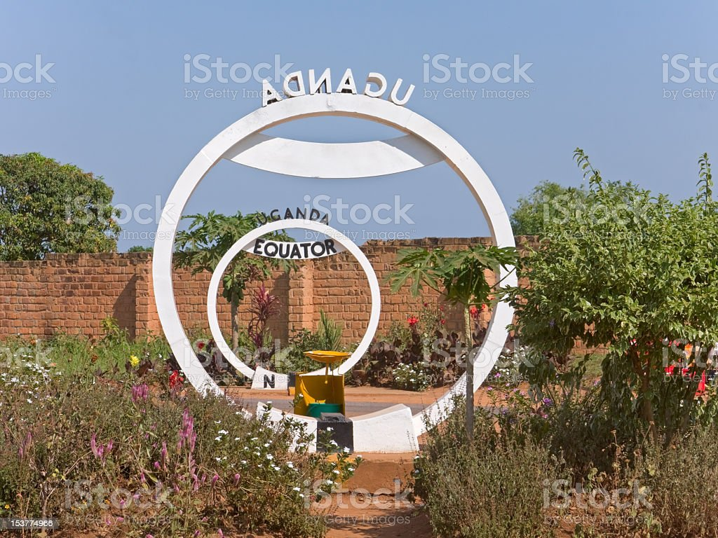 Two rings of Equator line crossing sign monument in Uganda stock photo