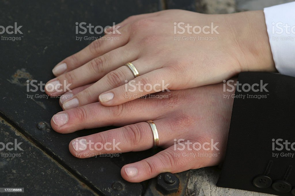 Just married couple - hands and wedding rings