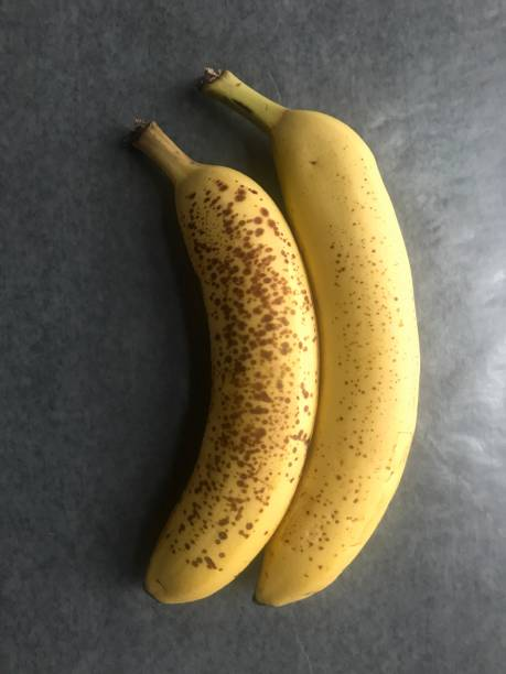 Two Ripe Bananas for Baking Two overripe bananas for baking or freezing     iPhone taken on mobile device stock pictures, royalty-free photos & images