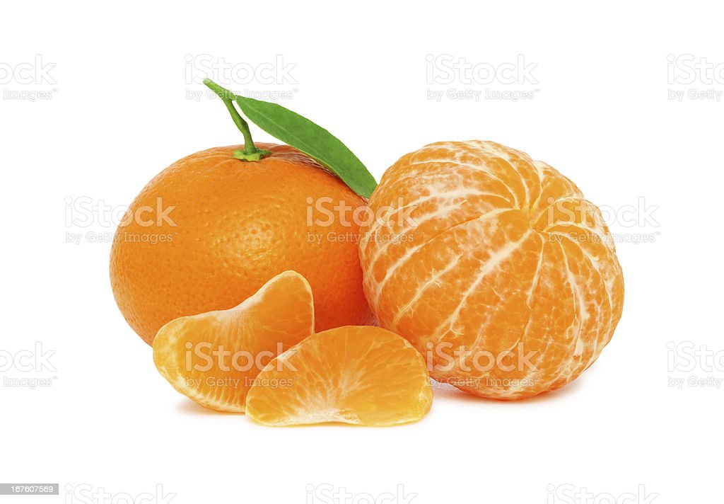 Two ripe mandarins and slices with green leaves (isolated) stock photo
