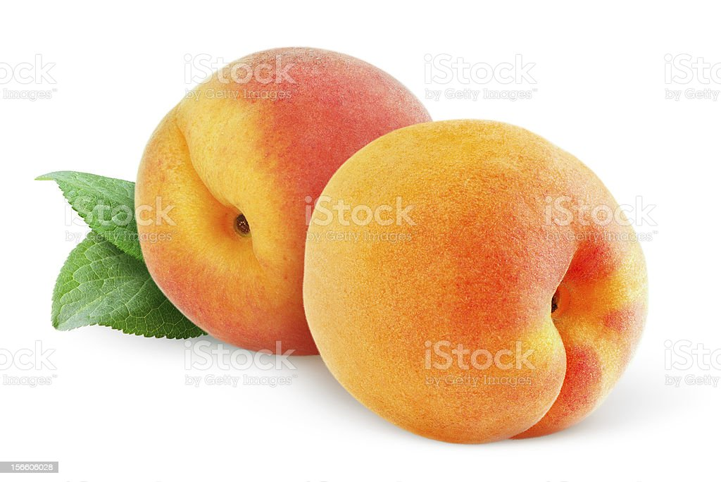 Two ripe peaches on a white background stock photo