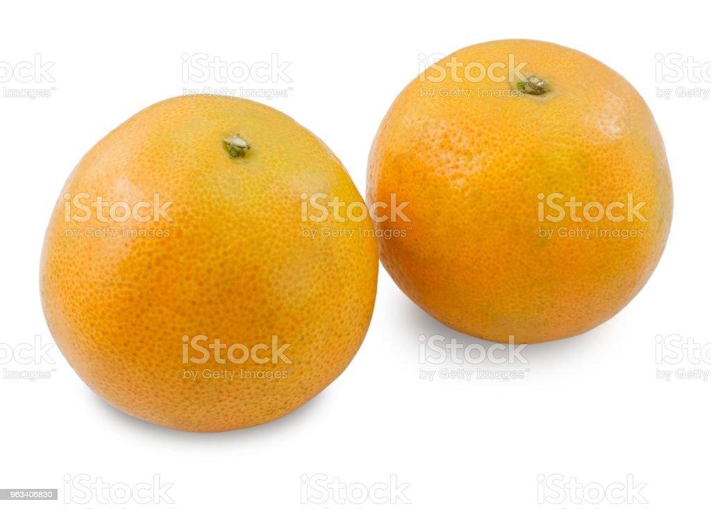 Dwa dojrzałe słodkie pomarańcze na białym tle - Zbiór zdjęć royalty-free (Deser)