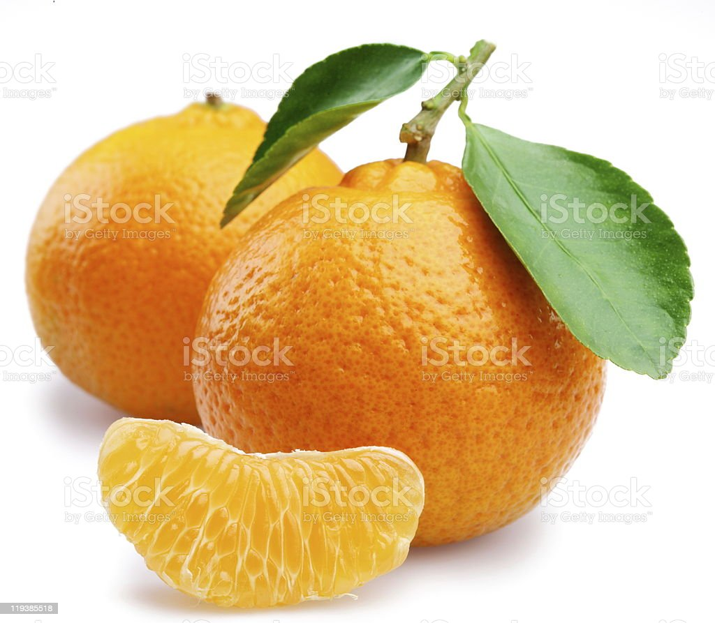 Two ripe tangerines with tangerine wedge on white background stock photo