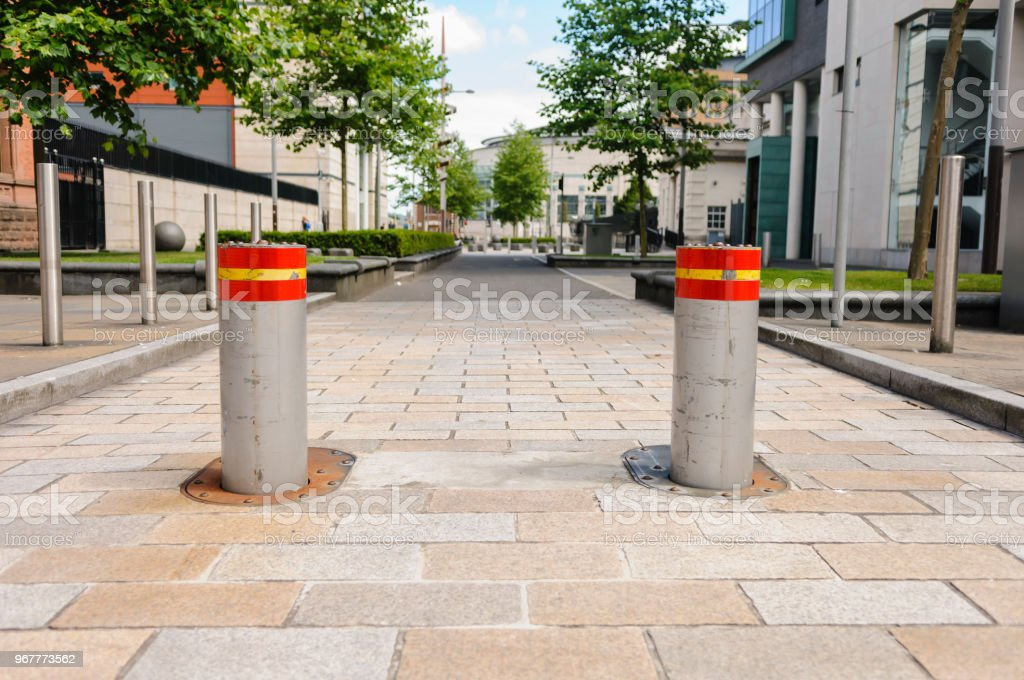 Two rising bollards at the Laganside Courts, Belfast stock photo