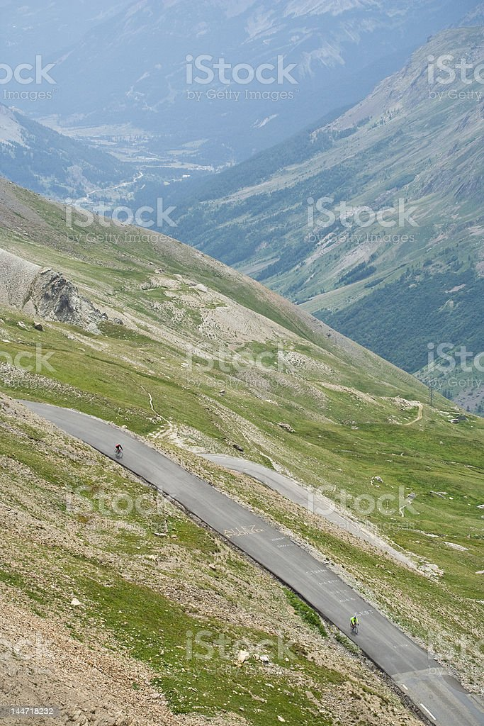 Two road racing cyclists in the Alps royalty-free stock photo
