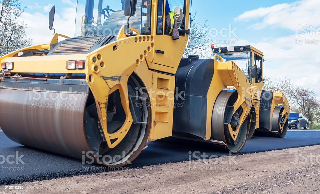 two road rollers stock photo