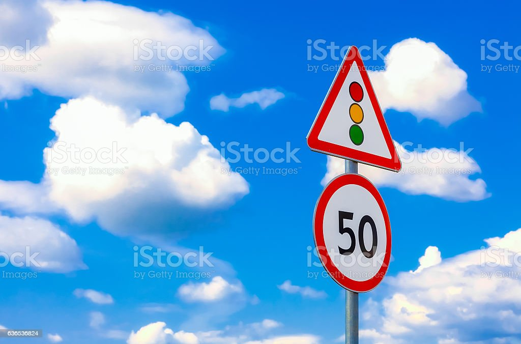 two road signs speed limit on a background of blue stock photo