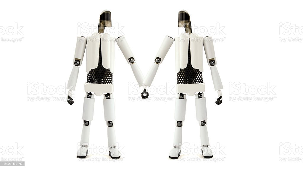 two robots hold hands stock photo