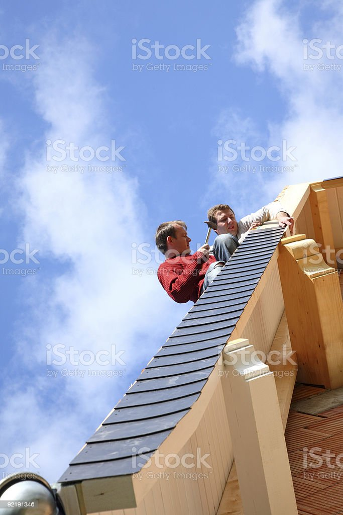 Two roofers. royalty-free stock photo