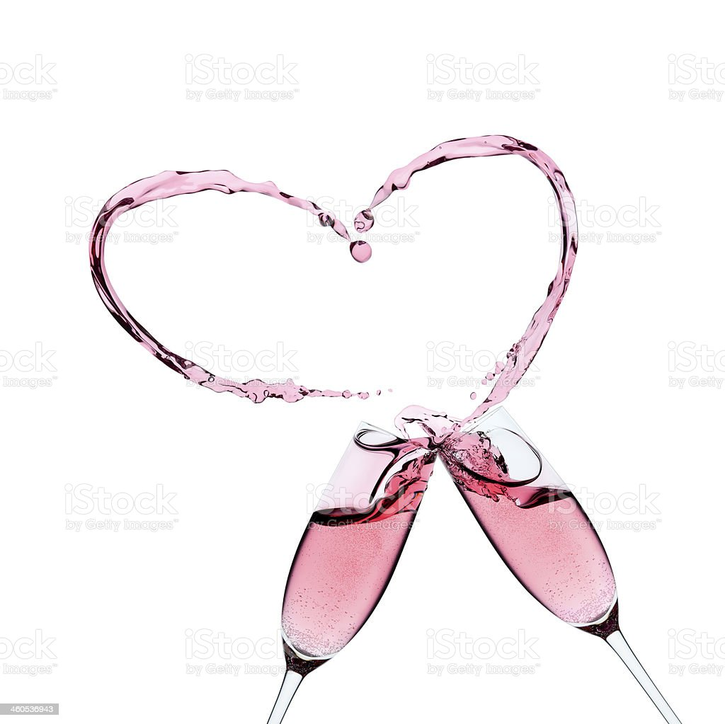 Two Rose champagne glasses with a splash stock photo