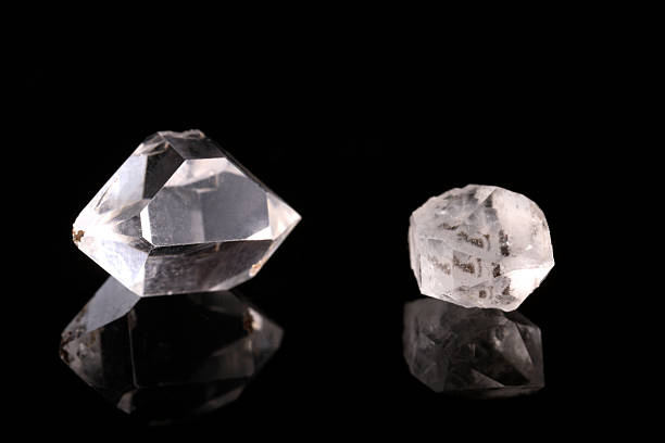 two rough diamonds - rough stock photos and pictures