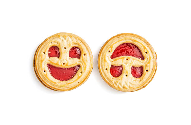 Two round biscuits smiling faces, humorous sweet food, isolated 스톡 사진