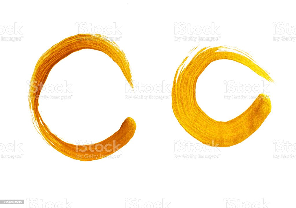 Duas pinceladas de ouro redondas - foto de acervo