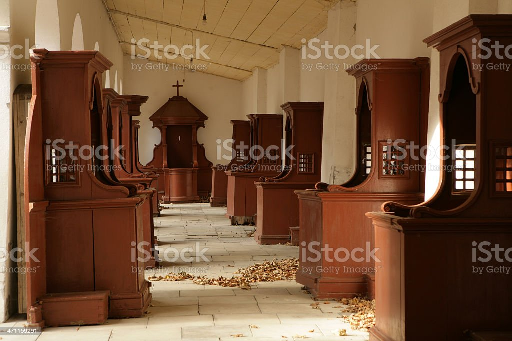 two rows of confessionals booths in monastery`s corridor royalty-free stock photo