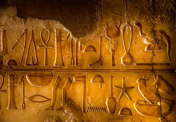 Two rows of Egyptian Hieroglyphics stock photo