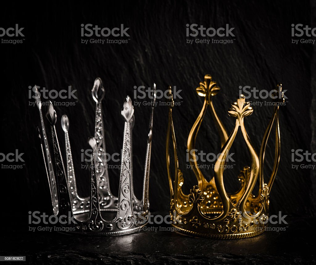 Two royal crowns with dark background stock photo