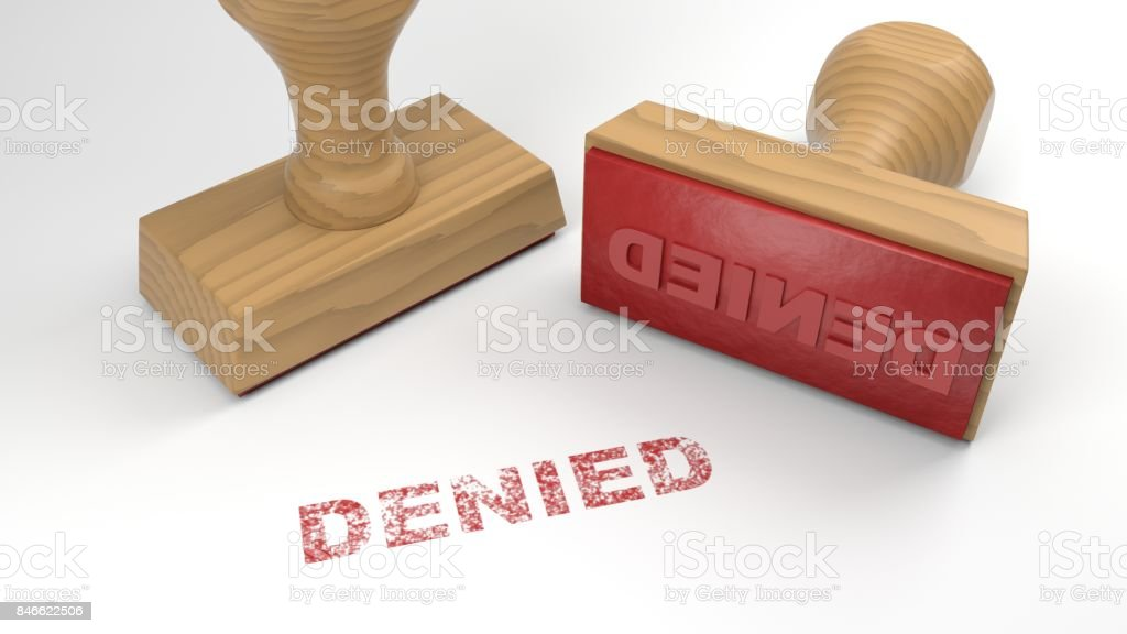 Two rubber stamps with the word denied on white rejection concept stock photo