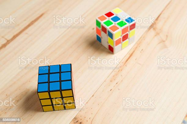 Two rubik cubes on a background of pine wood picture id538558616?b=1&k=6&m=538558616&s=612x612&h=x lfskxdoeviefpwq52khxpkp3zqjrgp7w uuwcy95i=